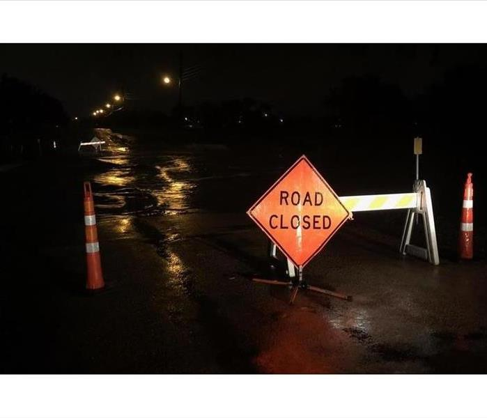 Road closed sign blocking a flooded street in San Angelo.